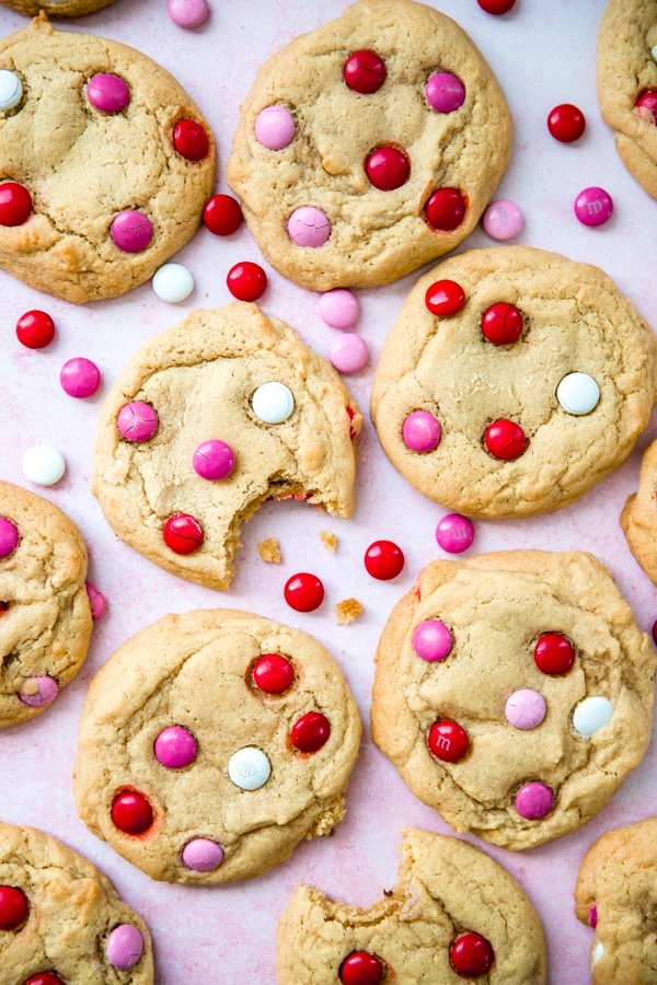 m&m cookies on a pink backdrop