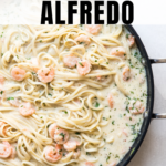 shrimp scampi in a large pan with parsley and parmesan cheese