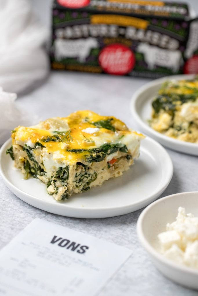 slice of artichoke spinach egg bake on white plate