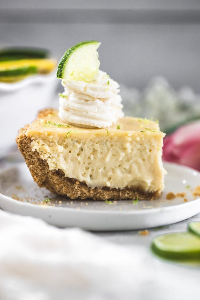 a slice of key lime pie with whipped cream on top