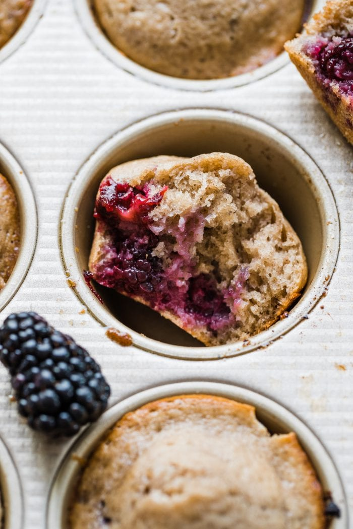 blackberry muffin in a muffin tin