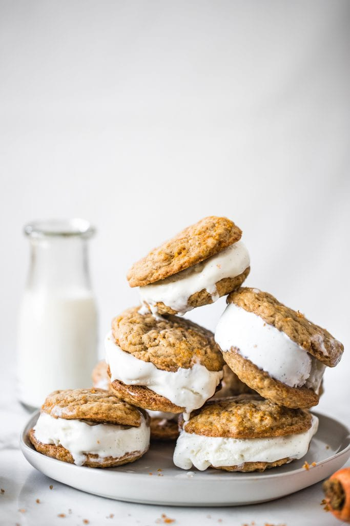 carrot cake ice cream sandwiches stacked together on a white plate