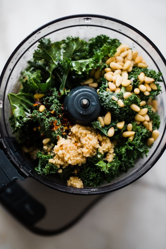 kale, pine nuts and garlic in a food processor