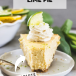 key lime pie on a white plate topped with whipped cream and a lime wedge