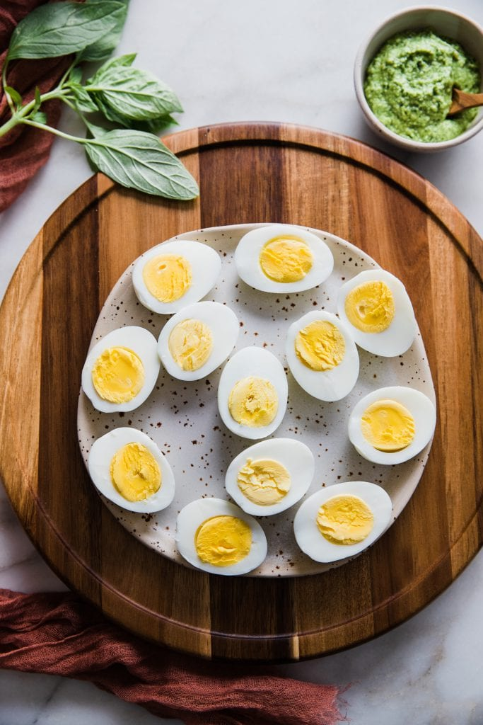 hard boiled eggs sliced in half on a plate