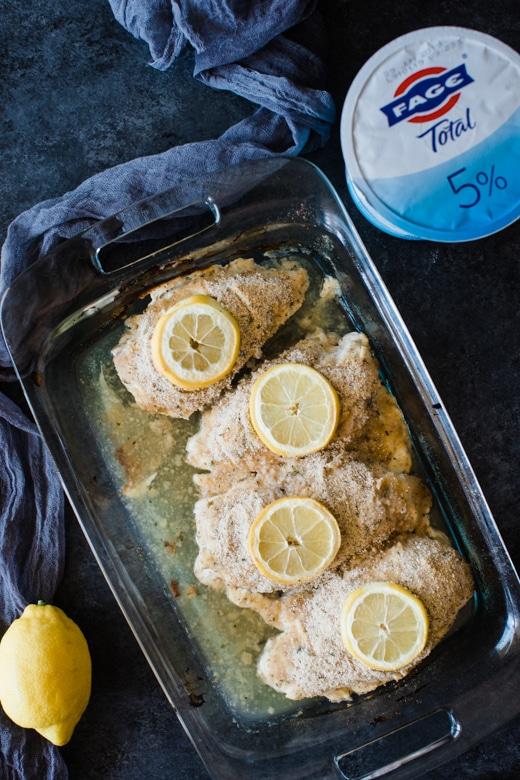 greek yogurt lemon baked chicken in a glass baking dish