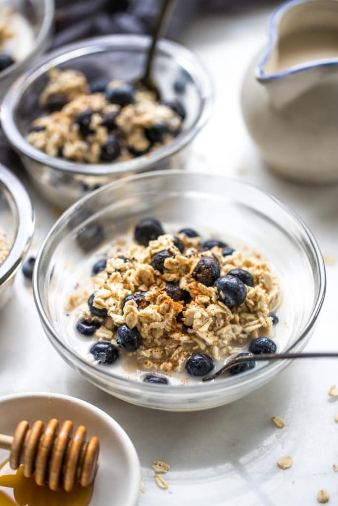 overnight blueberry oats in a glass bowl