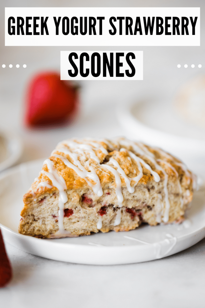 strawberry scones with frosting on a white plate