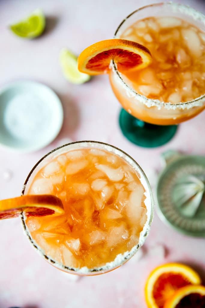 blood orange margarita in a margarita glass