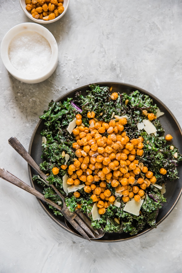 kale salad topped with roasted chickpeas