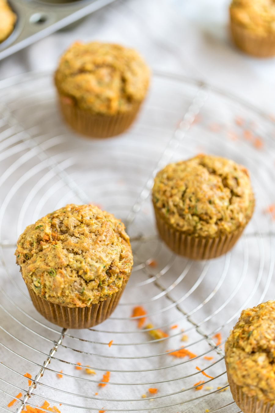 zucchini carrot muffins on a cooling rack