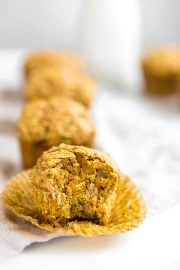zucchini carrot muffin on a cooling rack