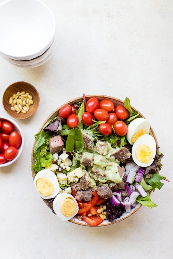 steak cobb salad on a white board