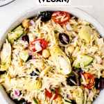 greek orzo pasta salad in a large white bowl
