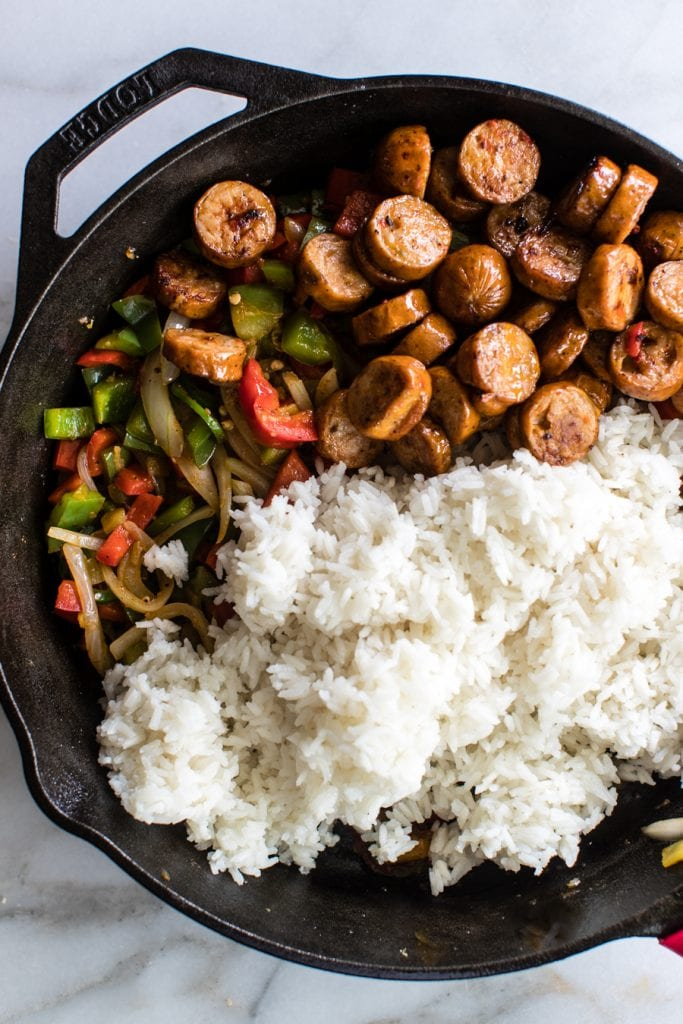 sausage, rice and bell peppers in a cast iron skillet