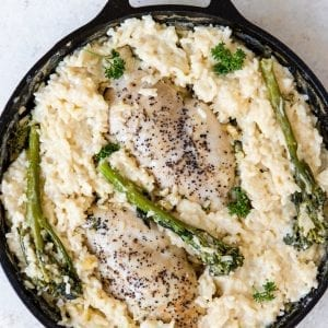 chicken and risotto in a cast iron skillet