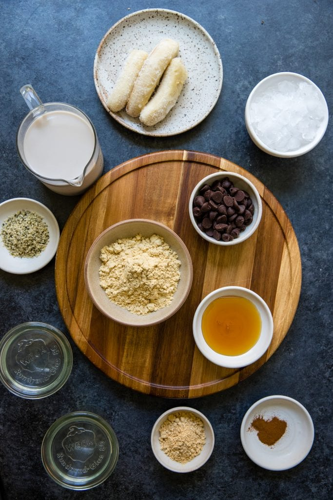 ingredients needed for vegan cookie dough smoothie in small bowls