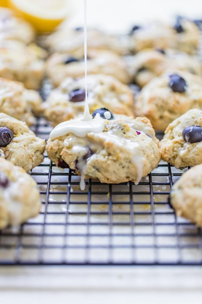 blueberry lemon cookies on a cooling rack with glaze on top