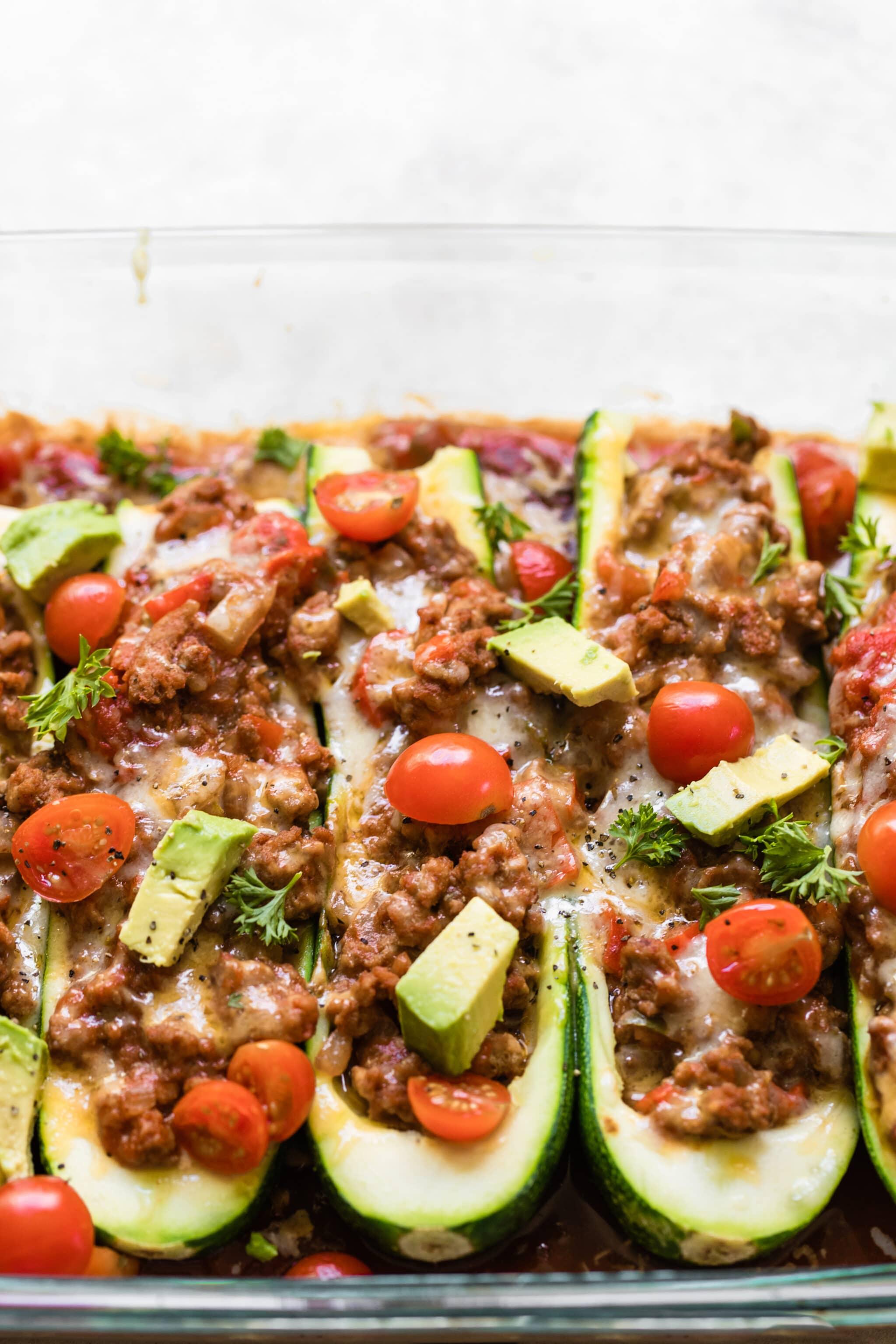 zucchini taco boats in a glass Pyrex dish