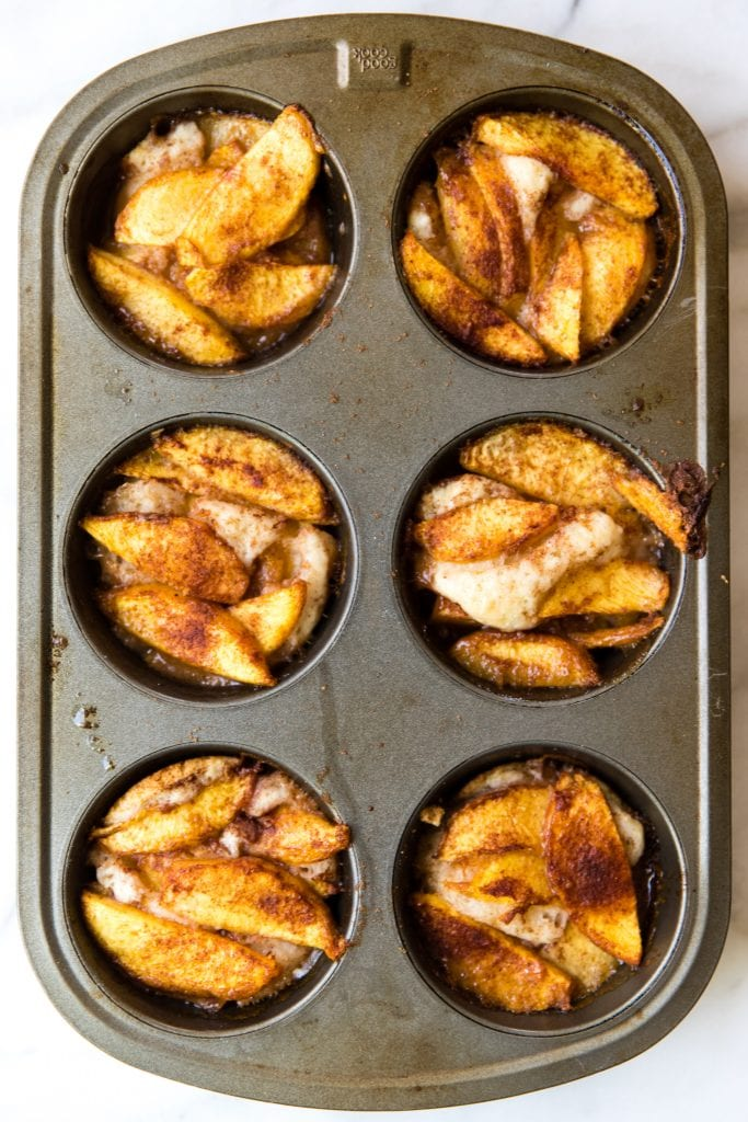 6 peach cobblers in a muffin tin