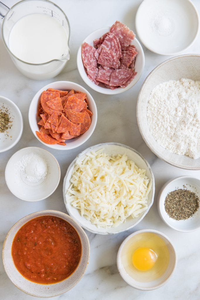 ingredients in glass bowls for Italian Pizza Bites
