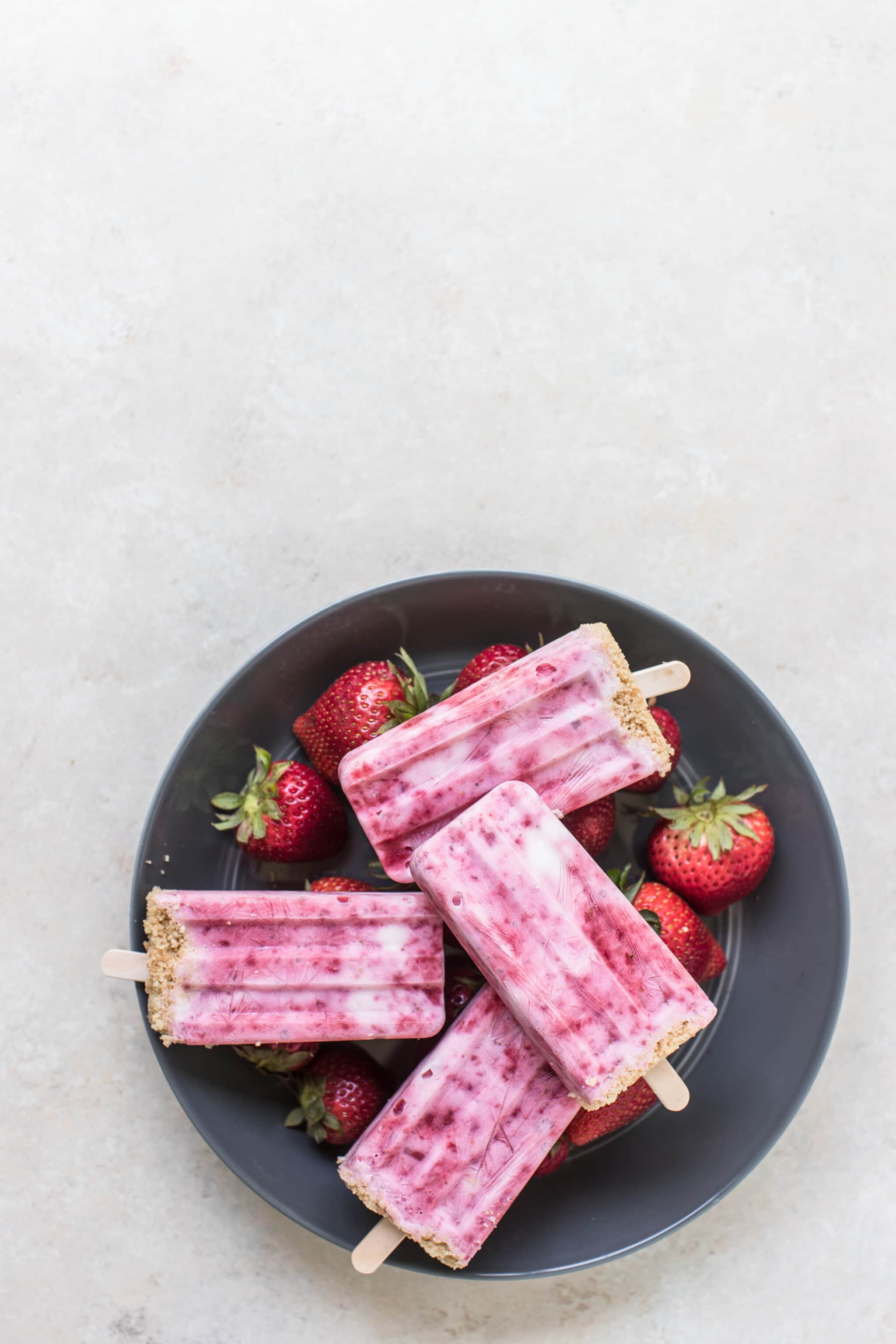 strawberry shortcake popsicles in a blue bowl