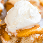 individual peach cobbler topped with vanilla ice cream