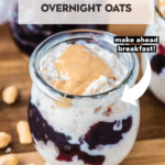 overnight oats in a glass jar topped with peanut butter