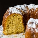Bacardi rum cake on a cake stand with powdered sugar