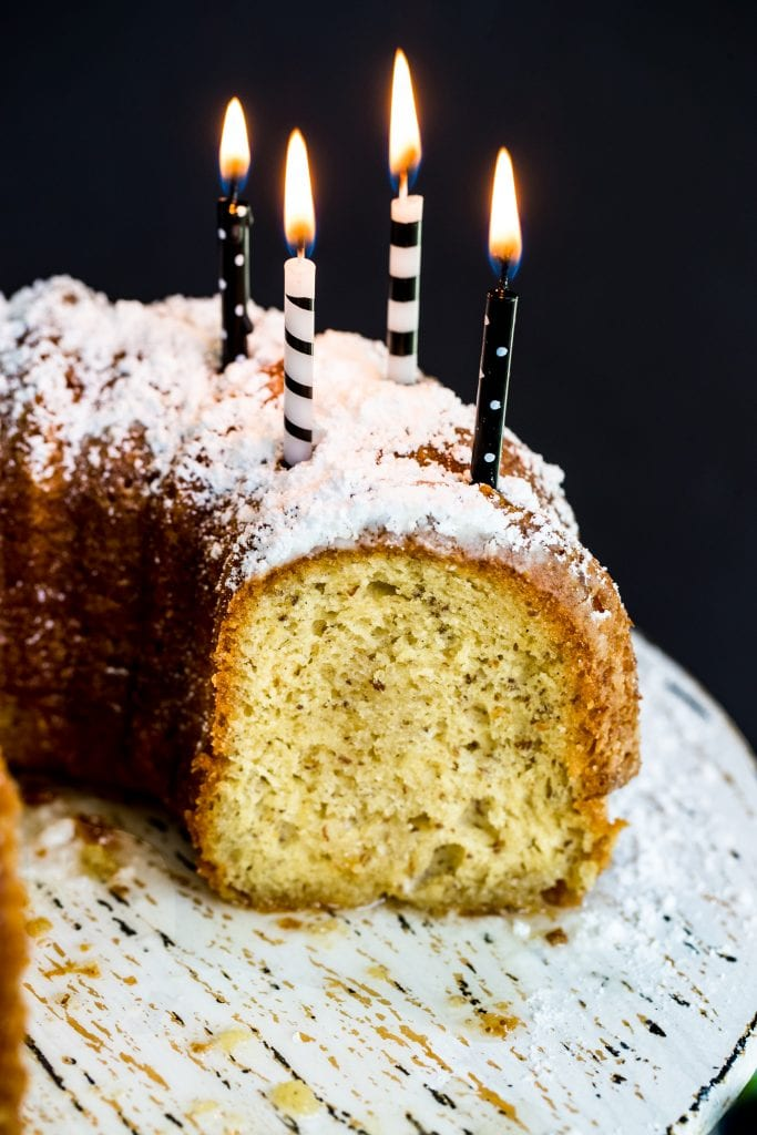 Bacardi rum cake on a cake stand with candles