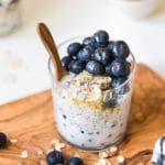 overnight oatmeal in a glass jar on a wooden cutting board