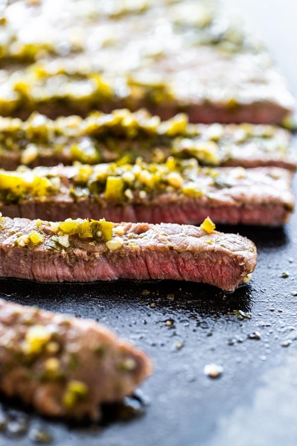 carne asada steak on a black cutting board