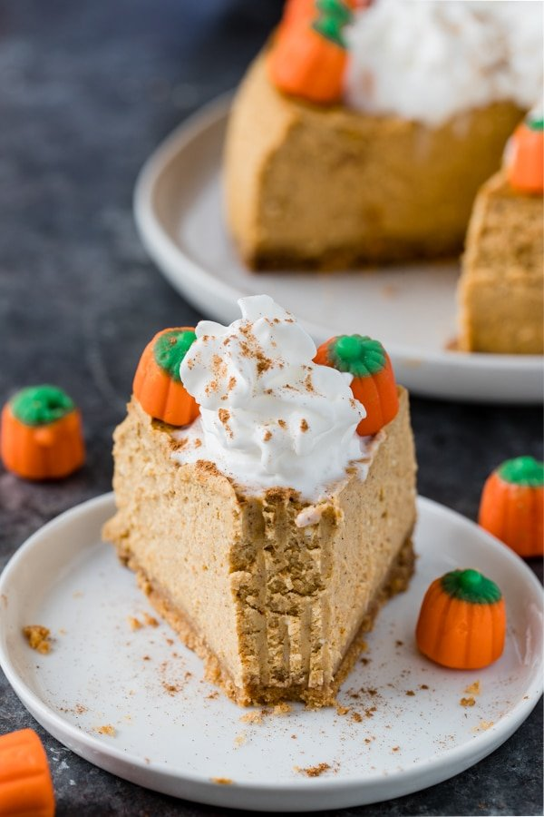 a slice of pumpkin cheesecake made in the instant pot on a white plate