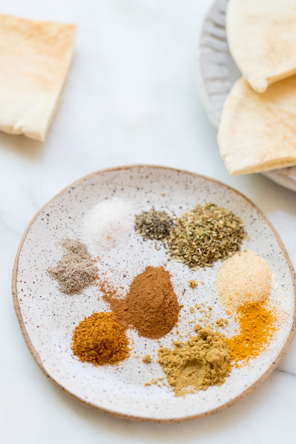 seasonings for chicken shawarma marinade on a plate
