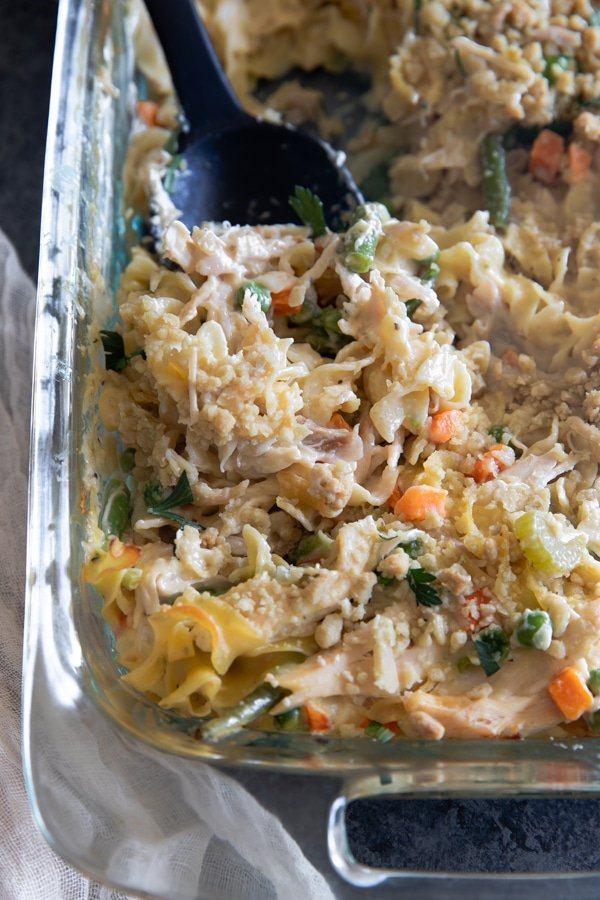 chicken pot pie casserole in a glass baking dish