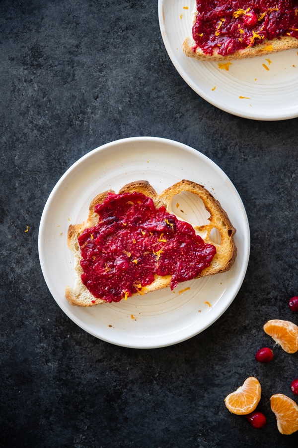 cranberry chia seed jam on sourdough toast on a white plate