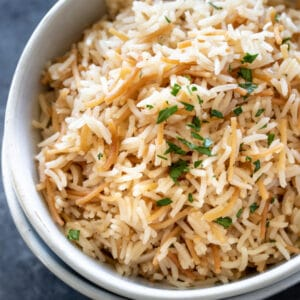 a white bowl filled with rice pilaf