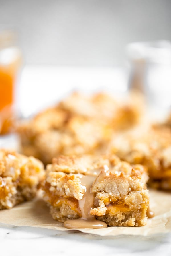 homemade apricot bars on a white board