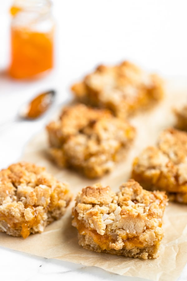 homemade apricot bars on parchment paper made with apricot preserves
