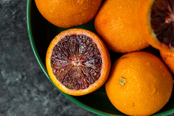 blood oranges in a green bowl