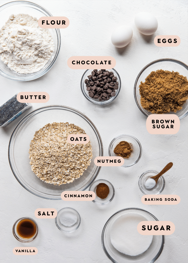 all of the ingredients for an oatmeal raisin cookie skillet in small bowls