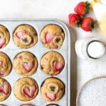 strawberry banana muffins in a muffin tin