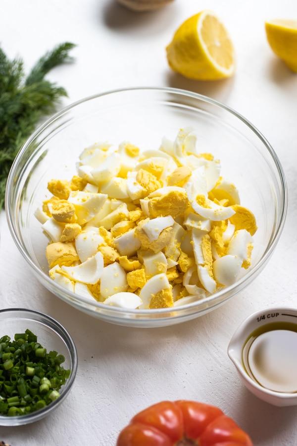 a glass bowl of chopped hard boiled eggs