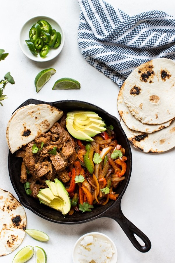 steak fajitas in a cast iron skillet