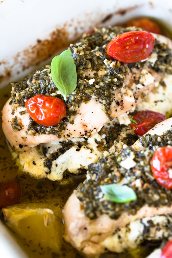 healthy pesto baked chicken in a baking pan