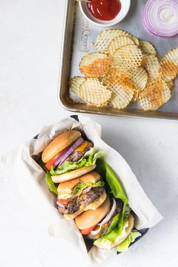 homemade ground beef burgers with fries