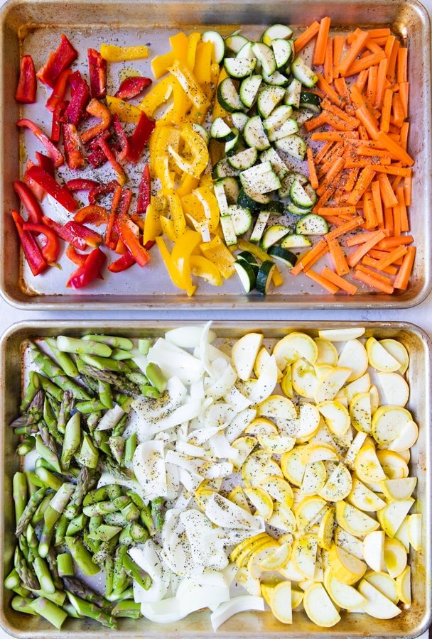 seasonal spring and summer vegetables on a baking sheet for healthy pasta primavera