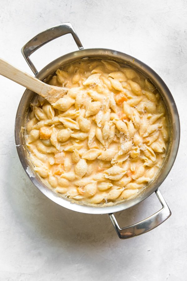 mac and cheese in a large pot made with butternut squash