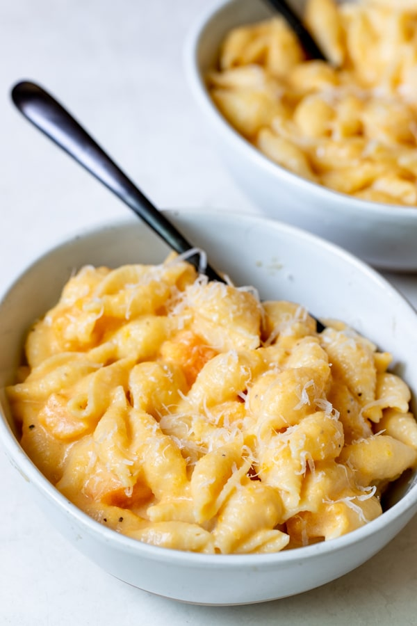 mac and cheese in a white bowl made with butternut squash