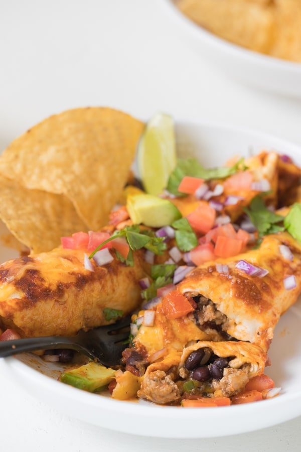 black bean enchiladas on a white plate